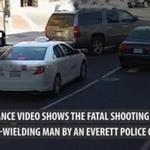 Surveillance video shows the fatal shooting of a knife-wielding man by an Everett police officer