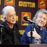 FILE - In this Oct. 9, 2012 file photo, Led Zeppelin guitarist Jimmy Page, left and singer Robert Plant appear at a press conference ahead of the theatrical release of