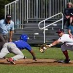 Chatham's D.J. Artis slid back as the throw goes to Yarmouth-Dennis's Brendan Skidmore in a game at Red Wilson Field in South Yarmouth — the first of five stops a reporter made on a one-day Cape Cod League odyssey.