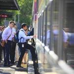 Commuters boarded a Commuter Rail train at the Chelsea platform.