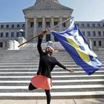 Katherine Day of Jackson, Miss., waved the flag of the Human Rights Campaign on the steps of the Mississippi Capitol in celebration of the judge's decision on Friday.