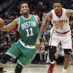 Apr 26, 2016; Atlanta, GA, USA; Boston Celtics guard Evan Turner (11) is defended by Atlanta Hawks forward Kent Bazemore (24) in the third quarter in game five of the first round of the NBA Playoffs at Philips Arena. The Hawks defeated the Celtics 110-83. Mandatory Credit: Brett Davis-USA TODAY Sports