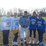 Lee Hutchens stood with students at the annual Norwood High School powder puff game.