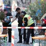 German police investigated the site in Ansbach, Germany, where a failed asylum-seeker from Syria blew himself up and wounded 15 people.
