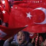 A woman in Taksim Square in Istanbul Monday waved a Turkish flag during a rally protesting the coup attempt in Turkey.