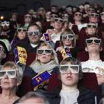 New technology may someday allow moviegoers to watch 3-D movies without the aid of plastic glasses.