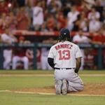 epa05446837 Boston Red Sox first baseman Hanley Ramirez of the Dominican Republic kneels on the mound in the bottom of the ninth inning during the MLB baseball game between the Boston Red Sox and the Anaheim Angels at Angel Stadium in Anaheim, California, USA, 28 July 2016. The Angels scored two runs in the bottom of the ninth inning to beat the Red Sox 2-1. EPA/PAUL BUCK