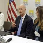 Gov. Rick Scott, center, flanked by Dr. Celeste Philip, State Surgeon General, left, and Dr. Paula Thaqi, Director of the Broward County Health Department, right, talks to community leaders, at the Broward County Health Department, Tuesday, July 26, 2016, in Fort Lauderdale, Fla. Gov. Scott reiterated the importance of Zika preparedness. The tropical mosquito that carries Zika, Aedes aegypti, likes to live near people and it doesn't travel far. Hand-spraying and removing the standing water where they breed, more extensive use of air conditioning and window screens, wider use of bug repellant and broader mosquito control measures will help control the spread of Zika by mosquitoes. (AP Photo/Alan Diaz)