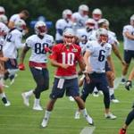 Foxborough-07/29/2016-The New England Patriots held their 2nd day of training camp at the practice fields of Gillette Stadium. Qb Jimmy Garoppolo leads the team in warmups. Boston Globe staff photo by John Tlumacki(sports)