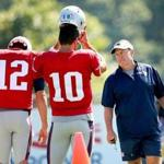 Foxborough- 8/3/2016- The New England Patriots practiced at their training camp at Gillette Stadium. Coach Bill Belichick chats with QB's Tom Brady and Jimmy Garoppolo. Boston Globe staff photo by John Tlumacki(sports)