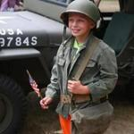 Joseph Clayton got to wear some vintage World War II items while visiting Fort Devens Museum's open house event.