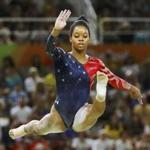 Gabrielle Douglas competes on the beam during the women's qualifications at the 2016 Rio Olympics.