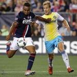 Revolution forward Juan Agudelo (17) held off Crew defender Nicolai Naess (24) during New England's dispiriting loss at Gillette Stadium on Saturday.
