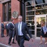Governor Charlie Baker left General Electric Co.'s temporary offices on Monday.