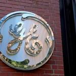 The GE logo at the front entrance of its Fort Point headquarters.