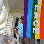 Neil Podolski was one of many Natick neighbors displaying the rainbow flag in support of Lauri and Cari Ryding.