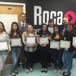 Graduates from the Roca-CVS Pharmacy Technician Training program received their certificates at Roca. a Chelsea-based nonprofit.