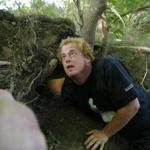 Dominic Kane stuck his arm into a hole as he searched for Wessie the missing python.