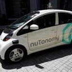 A nuTonomy self-driving taxi made its way down the road in its public trial in Singapore.