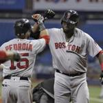 Boston Red Sox's David Ortiz, right, celebrates with Dustin Pedroia after Ortiz hit a two-run home run off Tampa Bay Rays starting pitcher Matt Andriese during the first inning of a baseball game Wednesday, Aug. 24, 2016, in St. Petersburg, Fla. (AP Photo/Chris O'Meara)