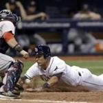 Tampa Bay Rays' Luke Maile, right, slides home to score the game-winning run as Boston Red Sox catcher Sandy Leon can't handle the throw during the 11th inning of a baseball game Wednesday, Aug. 24, 2016, in St. Petersburg, Fla. Rays won 4-3. (AP Photo/Chris O'Meara)