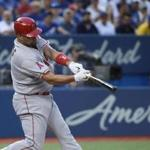 TORONTO, CANADA - AUGUST 24: Albert Pujols #5 of the Los Angeles Angels of Anaheim hits an RBI sacrifice fly in the second inning during MLB game action against the Toronto Blue Jays on August 24, 2016 at Rogers Centre in Toronto, Ontario, Canada. (Photo by Tom Szczerbowski/Getty Images)