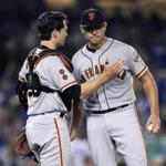 San Francisco Giants catcher Buster Posey, left, pats starting pitcher Matt Moore after Moore lost his no-hitter with two outs in the ninth inning of a baseball game against the Los Angeles Dodgers, Thursday, Aug. 25, 2016, in Los Angeles. The Giants won 4-0. (AP Photo/Mark J. Terrill)