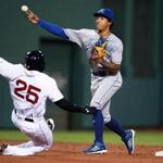 Royals second baseman Raul A. Mondesi successfully turned a double play in front of a sliding Jackie Bradley Jr. in the third inning.