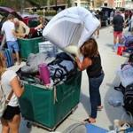 Family members and Boston University volunteers helped students move in to the West Campus dorms last year.