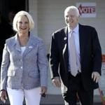 US Senator John McCain and his wife, Cindy, left a polling station after voting on Tuesday.
