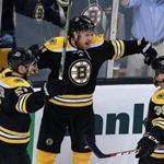 10/27/15: Boston, MA: The TD Garden faithful fans have not had much to cheer about so far this season as the Brins have yet to win on home ice, but after Jimmy Hayes(11) scored in the second period to put Boston ahead 2-0, they may just have a chance for their first home victory of the season. Hayes (center) celebrates with teammates Ryan Spooner (left) and Matt Beleskey (right). The Boston Bruins hosted the Arizona Coyotes in a regular season NHL hockey game at the TD Garden. (Globe Staff Photo/Jim Davis) section:sports topic:Bruins-Coyotes (1)