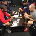 Red Sox players (front, from left) Chris Young and Travis Shaw play cribbage before a recent game at Fenway Park, while teammates (back, from left) Deven Marrero and Marco Hernandez play cards.