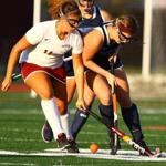 Swampscott's Sydney Faulkner (right) and Gloucester's Taylor Abbott battled for position.