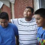 9/14/2016 (Boston area)- MA - Manuel Perez, cq, center, is a refugee from El Salvador. He moved to the Boston area two months ago and joined his mother and two younger brothers ), who were raised in the United States. Topic: 15refugee. Story by Maria Sacchetti/Globe Staff. Dina Rudick/Globe Staff.