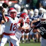 Danvers Ma 09172016 Central Catholic High School Quarterback #12 Bret Edwards (cq) looks to get off a pass as St. John's Prep #99 James Taylor (cq) right looks to break up play. Globe/Staff Photographer Jonathan Wiggs