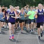 Norton, MA 092016 Norton High School....varsity runners Katie Bradley LEFT and Joey Annand RIGHT each hold the school's record in the 5K here leading team on lap around track before heading out into woods for 5K run......(George Rizer for the Globe) for SOWK....reporter Samuel Boyles