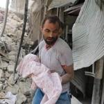A Syrian man carried the body of an infant retrieved from under the rubble of a building following a reported airstrike on Friday in the northern city of Aleppo. Missiles rained down on rebel-held areas of Aleppo, causing widespread destruction that overwhelmed rescue teams, as the army prepared a ground offensive to retake the city