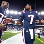 09/22/16: Foxborough, MA: A smiling Patriots quarterback Jacoby Brissett (7,right) is pictured as he leaves the field with teammate Devin McCourty (32, left) following New England's 27-0 victory over the Houston Texans. The New England Patriots hosted the Houston Texans in a Thursday night NFL regular season football game. (Globe Staff Photo/Jim Davis) section: sports topic: Patriots-Texans
