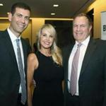 Celtics Coach Brad Stevens (left) with Linda Holliday and Patriots Coach Bill Belichick at the Seaport Hotel.