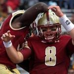 Boston College Eagles quarterback Patrick Towles, (8) and Boston College Eagles running back Jon Hilliman (32) celebrated after Towles ran the ball 17 yards for a touchdown in the first quarter.