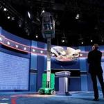 HEMPSTEAD, NEW YORK - SEPTEMBER 25: Workers make adjustments to the set for the first U.S. presidential debate at Hofstra University on September 25, 2016 in Hempstead, New York. Democratic presidential candidate Hillary Clinton is scheduled to debate Republican presidential candidate Donald Trump on Monday evening. (Photo by Drew Angerer/Getty Images