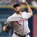 Sep 25, 2016; St. Petersburg, FL, USA; Boston Red Sox starting pitcher Eduardo Rodriguez (52) delivers a pitch against the Tampa Bay Rays at Tropicana Field. Mandatory Credit: Jeff Griffith-USA TODAY Sports