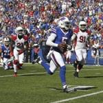 Buffalo Bills quarterback Tyrod Taylor (5) runs for a touchdown during the second half of an NFL football game against the Arizona Cardinals on Sunday, Sept. 25, 2016, in Orchard Park, N.Y. (AP Photo/Jeffrey T. Barnes)