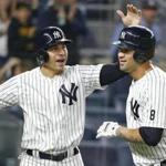 Jacoby Ellsbury (left) congratulated catcher Gary Sanchez on his two-run home run in the first inning.