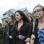 About 350 students marched at Boston College to protest the administration's non-response to an anti-LGBT slur on campus.
