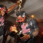 Sep 28, 2016; Bronx, NY, USA; Boston Red Sox first baseman Hanley Ramirez (13) is doused with champagne by a teammate after losing to the New York Yankees at Yankee Stadium but clinching their division with a Toronto Blue Jays loss. Mandatory Credit: Brad Penner-USA TODAY Sports