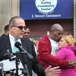 Attorney Robert Griffin, left, and Kyzr Willis parents Ralph Toney and Melissa Wills held a press conference in front of the Curley Community Center in South Boston on Friday.
