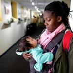 Watertown Ma 10062016 Infant teacher Victoria Jones (cq) with little Baby Katherine, at the Bright Horizons Day Care facility in Watertown.The two had just returned from a walk outside. They are photographed for TPTW Magazine Edition. Boston Globe Staff/Photographer Jonathan Wiggs