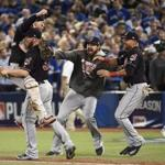 FILE- In this Wednesday, Oct. 19, 2016, file photoCleveland Indians relief pitcher Cody Allen (37), cather Roberto Perez (55) and teammates Andrew Miller and Coco Crisp celebrate the team's 3-0 victory over the Toronto Blue Jays during Game 5 of the baseball American League Championship Series, in Toronto. Four months after LeBron James and the Cavaliers ended the city's championship drought at 52 years by winning the NBA title, the Indians are back in the World Series for the first time since 1997. (Nathan Denette/The Canadian Press via AP, File)