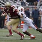Boston College quarterback Patrick Towles (8) is wrapped up by Syracuse linebacker Parris Bennett (30) during the first half of an NCAA college football game, Saturday, Oct. 22, 2016, in Boston. (AP Photo/Mary Schwalm)